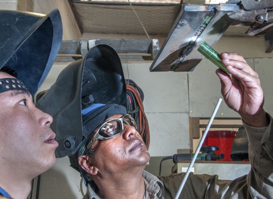 welding student and tutor